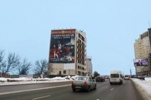 Монтаж крупноформатного баннерного панно «ЮНИОН» с рекламой обновленной коллекции